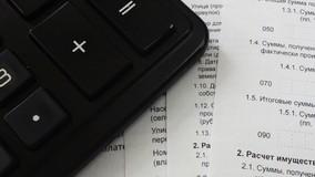 УО заплатила налоги только после угрозы остаться без имущества